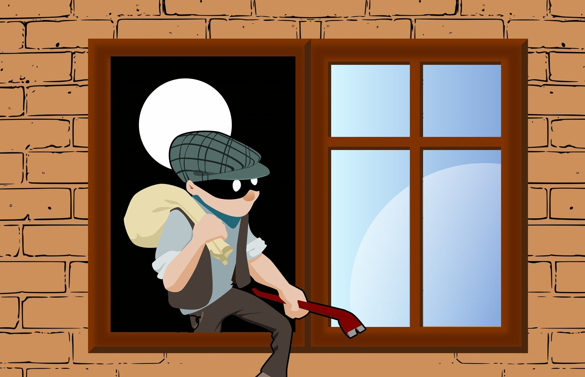 Thief climbing out of window